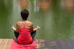 Meditating by the pond Stock Images