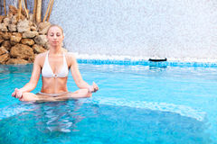 Meditating in the pool Stock Photos