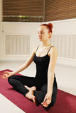 Meditating redhead Stock Photography