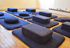 Meditation Cushions in Meditating Room Buddhism Dharma Session. Meditation Cushions in Meditating Room for Relaxing and Peaceful Class Buddhism stock photo