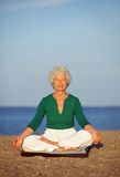 Meditating by the sea Stock Photos