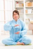 Meditating sitting woman Stock Images