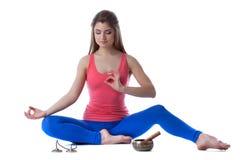 Meditating slender brunette isolated on white Stock Image
