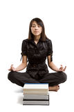 Meditating student stock images