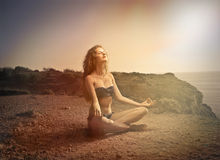 Meditating in the sun Stock Image