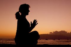 Meditating in Sunset Stock Image