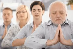 Meditating team portrait Stock Photos