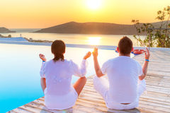 Meditating together at sunrise. Couple meditating together at sunrise Royalty Free Stock Photo