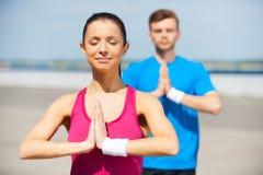 Meditating together. Stock Photos