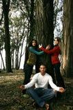 Meditating and tree hugging Royalty Free Stock Photography