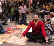 Meditating on Wall Street Stock Photos