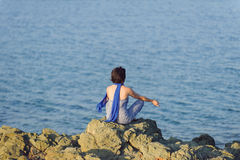 Meditating Woman with Blue Scarf Royalty Free Stock Image