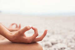 Meditating. Woman doing yoga. Close-up Royalty Free Stock Photos