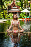 Meditating. Woman doing yoga Stock Photography