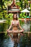 Meditating. Woman doing yoga. Woman doing yoga and meditating in the lotus position Stock Photography