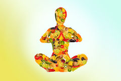 Meditating woman from fruit and vegetables Stock Photo