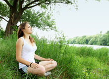 Meditating stock photo
