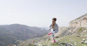 Meditating woman among natural views stock video footage