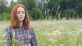 Meditating woman in nature, young lady sits in meditation eyes closed, serenity stock video