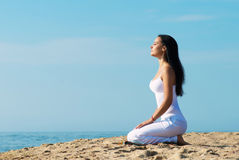 Meditating woman, outdoors portrait Royalty Free Stock Photography