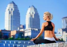 meditating woman in siddhasana yoga pose Royalty Free Stock Photo