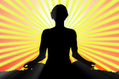 Meditating woman silhouette Royalty Free Stock Images