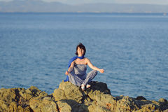 Meditating Woman at Sunset Royalty Free Stock Photos