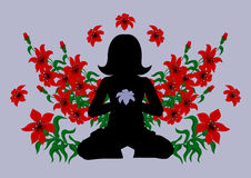 Meditating woman surrounded with flowers Royalty Free Stock Photography