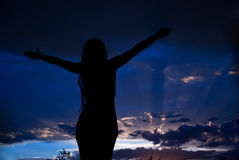 Meditating woman to clouds sky stock image