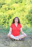 Meditating woman Stock Images