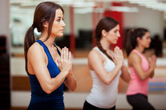 Meditating during yoga class Royalty Free Stock Photo