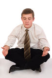 Meditating young businessman Royalty Free Stock Photo