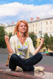 Meditating young ginger woman Royalty Free Stock Images