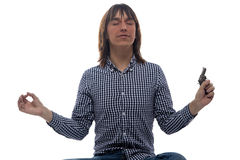 Meditating young man with the gun. On white background Stock Photos