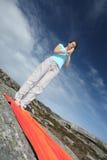 Meditating young woman. Exercising outdoor Royalty Free Stock Photo