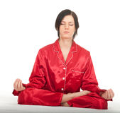 Meditating young woman in lotus position Stock Image
