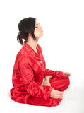 Meditating young woman in lotus position Stock Images