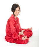 Meditating young woman in lotus position Royalty Free Stock Photography