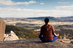 Meditation. Young woman is relaxing and enjoying mountain lookout in Blue Mountains, NSW, Australia royalty free stock photos