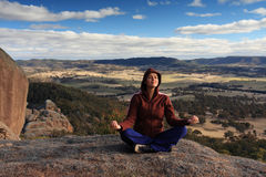 Meditation. Young woman is relaxing and enjoying mountain lookout in Blue Mountains, NSW, Australia stock images