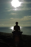 Meditation. At sunrise, tropical beach Stock Photo