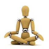 Meditation. Meditating wooden mannequin on white background Stock Images