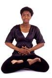 Meditation. A young beautiful woman meditating stock photos