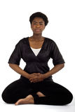 Meditation. A young beautiful woman meditating royalty free stock photos