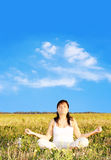 Meditation. Young woman meditating in the nature Stock Photo