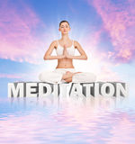 Meditation. Young  woman meditating  on word meditation over abstract sky Stock Images