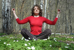 Meditation. Young female is maditating in the forest stock photos