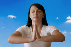 Meditation. Woman meditating outdoors. Focus is on the hands, a head is blurry Stock Images