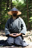 Meditation. Samurai men relaxing by meditation Stock Photography