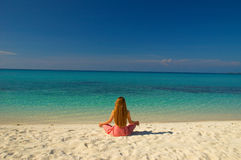 Meditation. On the beautiful Maldivian beach stock images